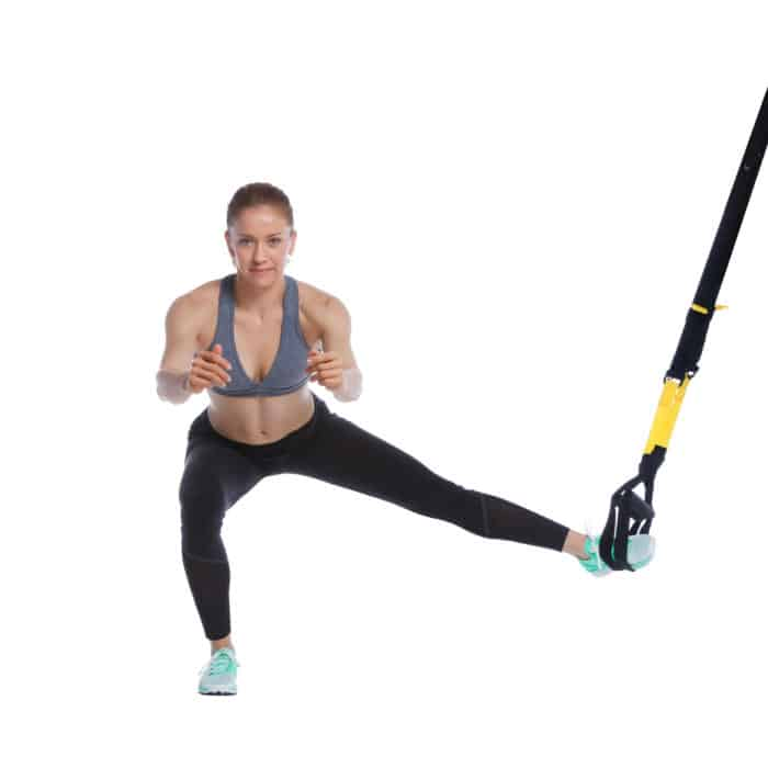 Girl Performing TRX Lateral Squat