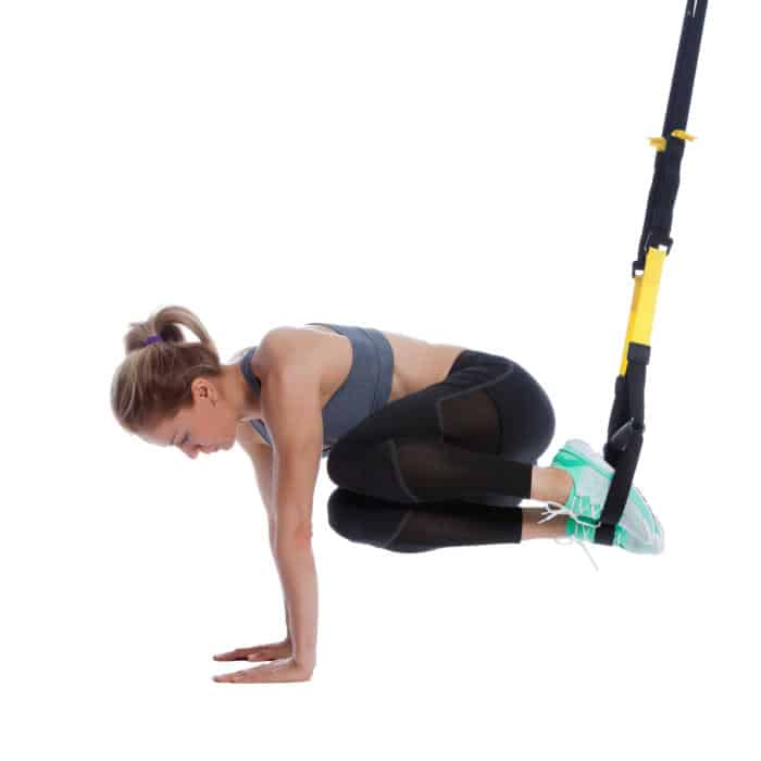 Girl Performing TRX Oblique Crunch